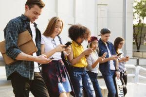 Millennials using smartphones outdoors